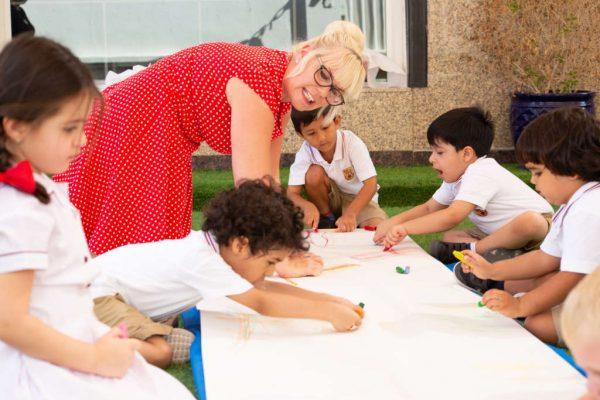 Shonette working with children in Dubai
